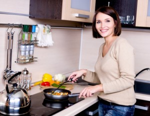 Woman saucepan cooktop