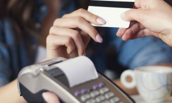 Women making payment using credit card