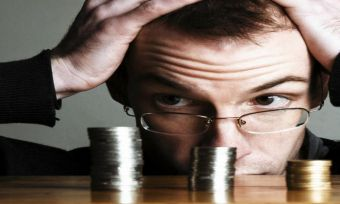 Man looking at coins stressec