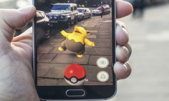 Person playing pokemon go in street