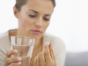 Woman confused pill