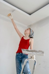 Woman ceiling scrapper