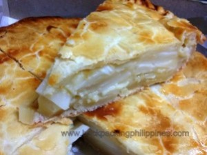 Filipino Buko pie is a desert made with coconut meat, coconut milk, sugar and cornstarch.