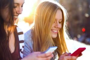Women texting smartphones